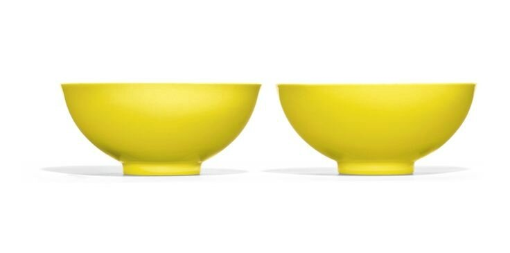 A pair of Imperial lemon-yellow glazed bowls, Yongzheng marks and period