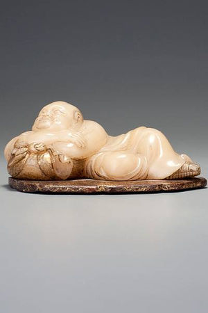 A_carved__bai_furong__recumbent_figure_of_Maitreya__by_Zhou_Bin