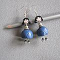 Boucles poupées jupes bleues