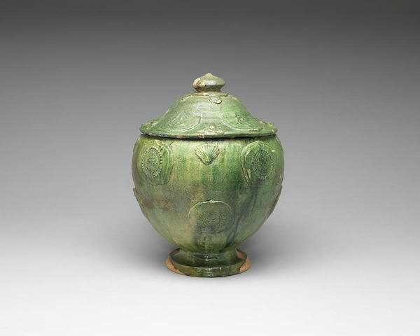 A green-glazed Buddhist funerary jar and cover,Liao Dynasty or later