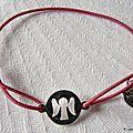 bracelet_pastille_ange_sur_fil_elastique__fushia_