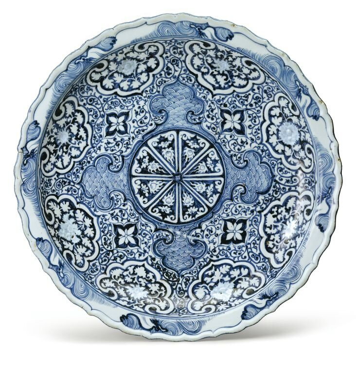 A Rare Molded Blue and White Barbed Rim Dish, Yuan Dynasty, 14th Century. Diameter 18 in., 45.7 cm. Est. $200/300,000. Sold for $4,197,000. Photo: Sotheby's