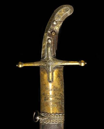 An_historic_gem_set_and_gilt_silver_mounted_Islamic_saber_attributed_to_Tipu_Sultan_and_captured_at_the_Siege_of_Seringapatam_in_17993