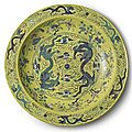 A massive yellow-ground green and aubergine 'dragon' charger, qing dynasty, guangxu period (1875-1908)