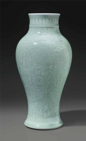 A celadon-glazed carved baluster vase, China, Qing dynasty, Kangxi period (1662-1722)
