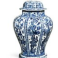 A large facetted blue and white baluster jar and cover,