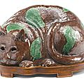 A chinese export aubergine and green-glazed biscuit 'cat' night light, circa 1800
