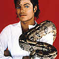 Entertainer-Michael-Jackson-poses-with-his-pet-boa-constrictor-in-1987