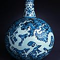 Flask with white dragons on blue waves.