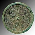 A chinese ming dynasty bronze mirror. china, ca. 14th to 17th century ad