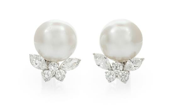 A Pair of Platinum, 18 Karat White Gold, Cultured South Sea Pearl and Diamond Earclips, Cartier