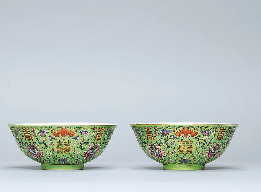 A pair of green-ground famille rose 'Double Happiness' bowls, Daoguang six-character seal marks in iron red and of the period