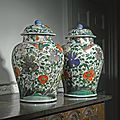 A large pair of chinese famille-verte baluster jars and covers, qing dynasty, kangxi period