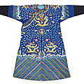 A fine padded silk dragon robe with gold thread embroidery of nine dragons among clouds and few auspicious symbols, guangxu