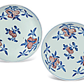 A pair of Ming-style blue and white and copper-red 'peach' dishes, Qianlong six-character seals mark in underglaze blue and of the period (1736-1795)