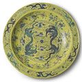 A massive yellow-ground green and aubergine 'dragon' charger. qing dynasty, guangxu period