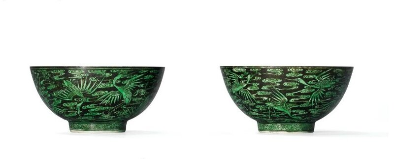 A very rare pair of famille noire green-enamelled 'cranes and clouds' bowls, Kangxi six-character marks within double circles in underglaze blue and of the period (1662-1722)