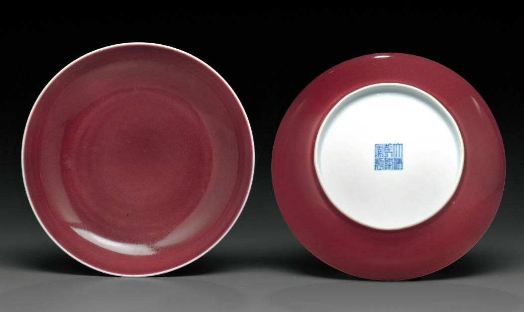 A pair of copper-red-glazed dishes, Qianlong six-character seal marks in underglaze blue and of the period (1736-1795)