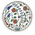An iznik polychrome pottery dish with hyacinths, tulips and roses, turkey, circa 1575