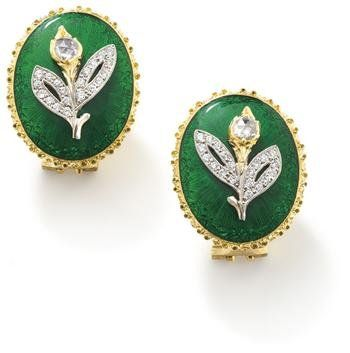 A_pair_of_diamond_and_enamel_earclips__by_Buccellati