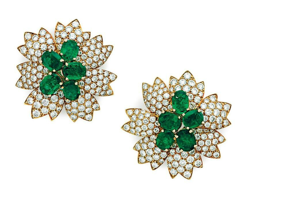 A pair of diamond and emerald ear clips, by Van Cleef & Arpels