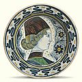 Italian, tuscany or umbria, circa 1450-1470, dish painted with a contour portrait of a young man