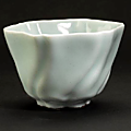 A celadon glazed porcelain floriform cup. qianlong mark and period