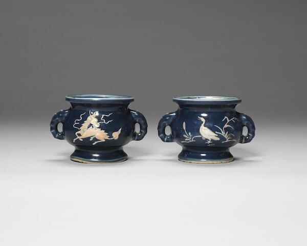 A pair of biscuit-decorated blue-glazed incense burners, gui, Wanli