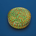 A sancai-glazed circular box and cover, Tang dynasty (618-907)