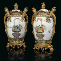 A pair of french ormolu-mounted samson famille vert porcelain vases and covers. the mounts of louis xv style, late 19th century