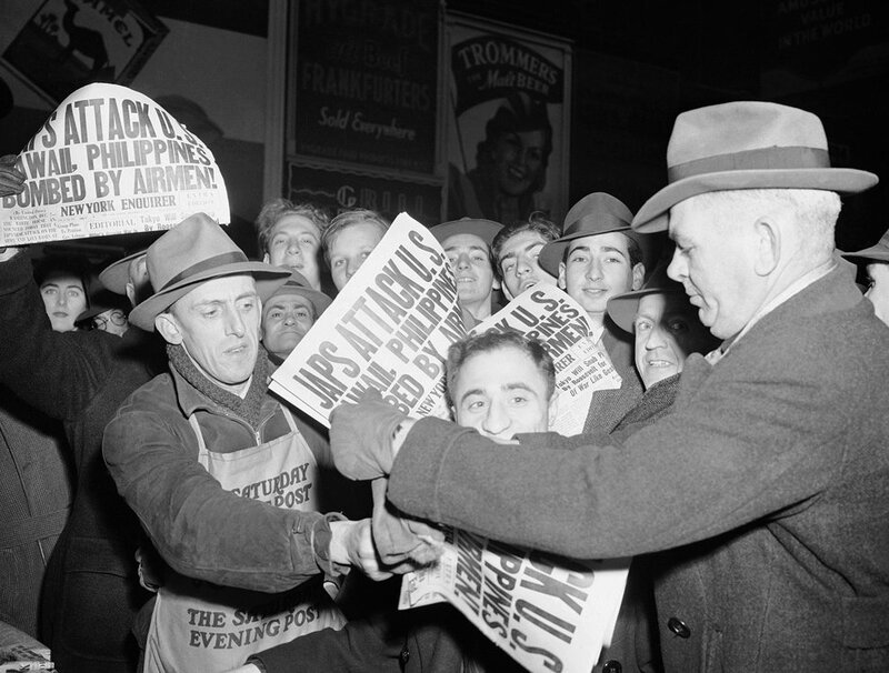 newspapers-go-on-sale-on-december-7-1941-in-times-square-in-new-york-city