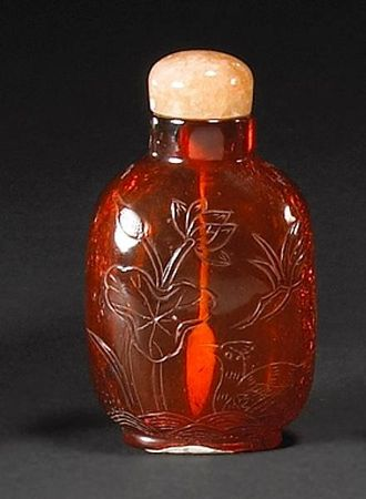 An_amber_snuff_bottle_Melikian