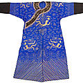 A blue silk gauze dragon robe with couched gold thread dragon motifs and black cuffs, china, guangxu period