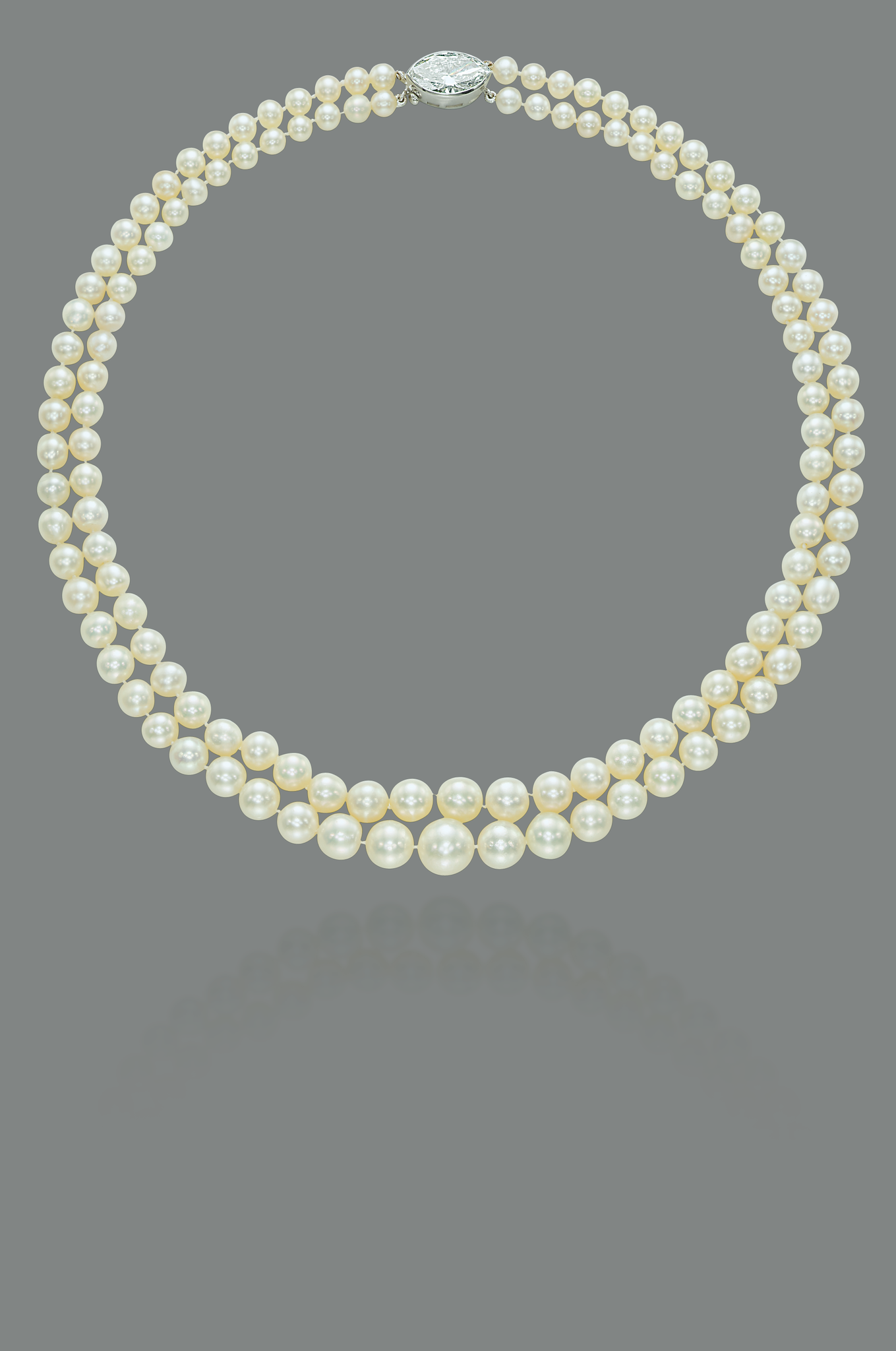 An exceptional two-strand natural pearl and diamond necklace