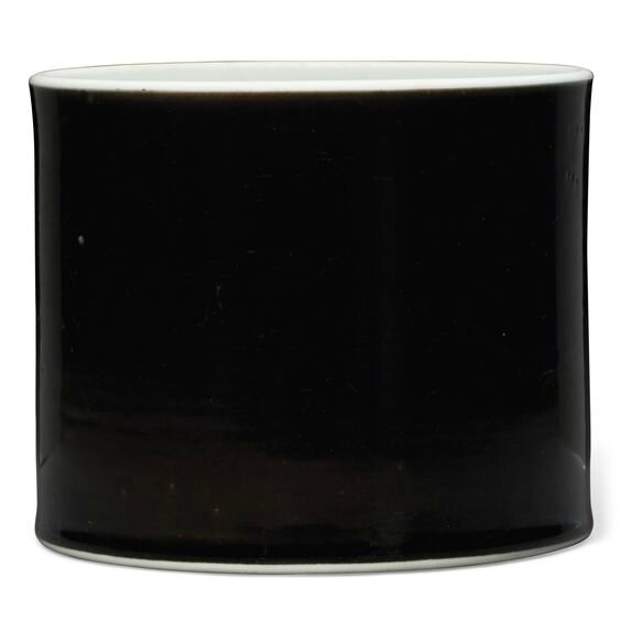A mirror-black-glazed brushpot, Kangxi period (1662-1722)