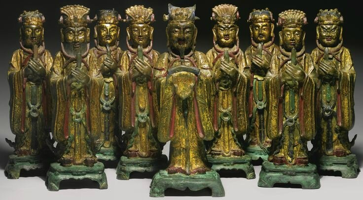 A rare set of gilt-lacquer and polychrome bronze figures of the nine emperor gods, China, Ming dynasty