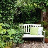 Garden-with-bench-and-cushions-housetohome