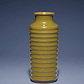 A fine and rare 'eel-skin' glazed cylindrical 'ribbed' vase, Yongzheng four-character incised seal mark and of the period (1727-1735)
