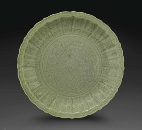A large carved Longquan celadon bracket-lobed dish, Ming Dynasty, 14th-15th Century