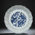 A superb and extremely rare early ming blue and white 'dragon and phoenix' brushwasher, yongle period (1403-1424)