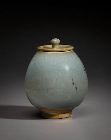 A pale blue Junyao 'lotus bud' waterpot and cover, Jin dynasty