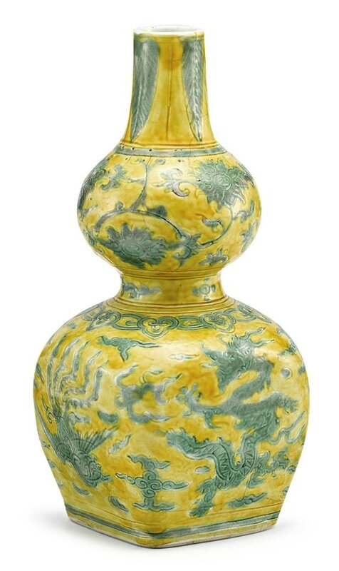 An extremely rare yellow-ground and green-enamelled 'Dragon and Phoenix' double gourd vase, mark and period of Jiajing