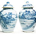 A pair of blue and white landscape vases and covers, Qing dynasty, 18th century