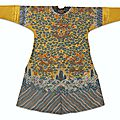 An imperial yellow-ground kesi 'twelve symbols' semi-formal 'dragon' robe, jifu, qing dynasty, 19th century