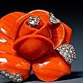 Cartier. a striking coral and diamond flower brooch. paris, circa 1960