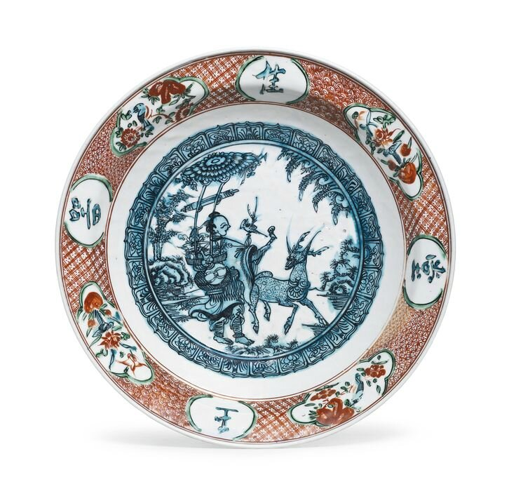 A large polychrome 'Zhangzhou' 'Magu' dish, Late Ming dynasty, 16th-17th century