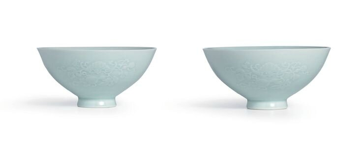 A rare pair of moulded celadon-glazed 'Bats and Gourds' bowls, Marks and period of Yongzheng