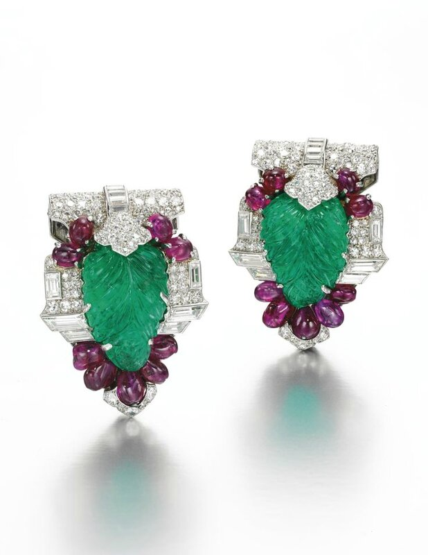 Pair of fine gem set and diamond clips, Cartier, circa 1930