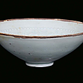 A blue earthenware bowl with vegetables and children decorations, China, Song Dynasty (960-1279)