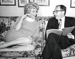1958_marilyn_sign_contract_for_SLiH_2_1_w_Harold_Mirish_1